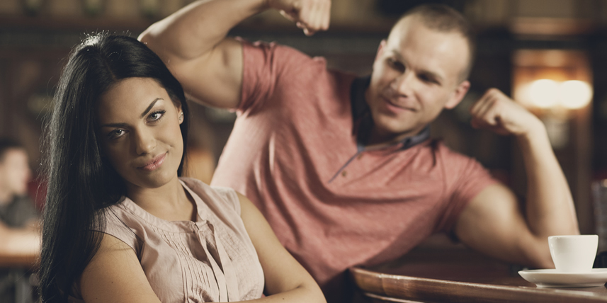 man-showing-muscles-on-a-bad-date