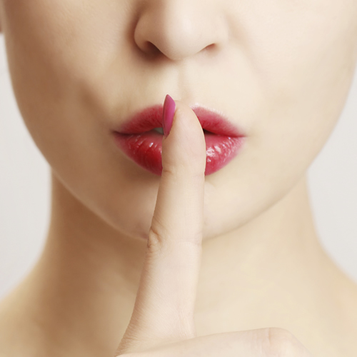 woman-hushing-with-finger-on-lips_500x500