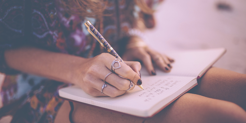 woman-writing-in-her-diary